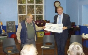 Dr Holt was presented with a cheque: On behalf of the Talley Village dinner.