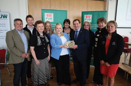 Winners: Rita Jones and the FLS receive FUW award from deputy minister for farming and food Rebecca Evans and retiring FUW president Emyr Jones.
