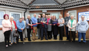 Council Chairman Peter Hughes Griffiths: Cuts the ribbon unveiling the new set of apartments