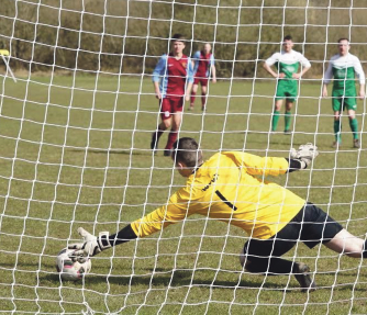 Winning penalty: Stuart Rees slots home the decider (Pic: Alan Evans)