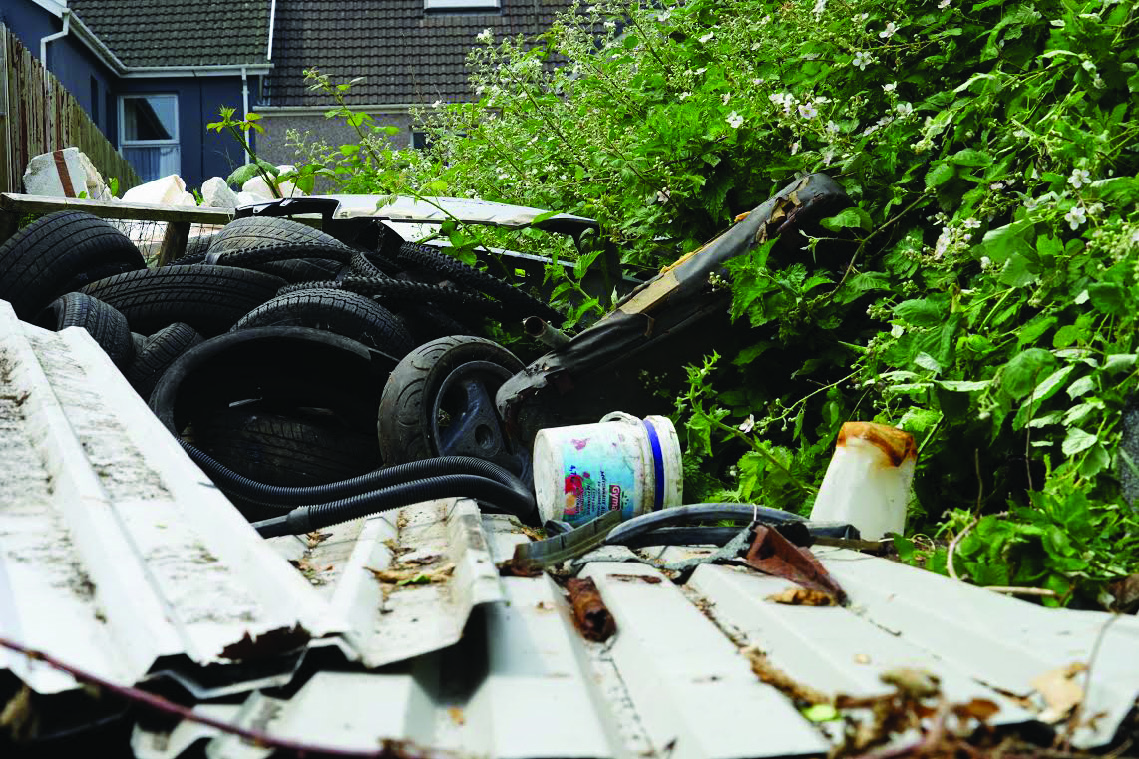 Eyesore: Rubbish strewn in neighbouring gardens