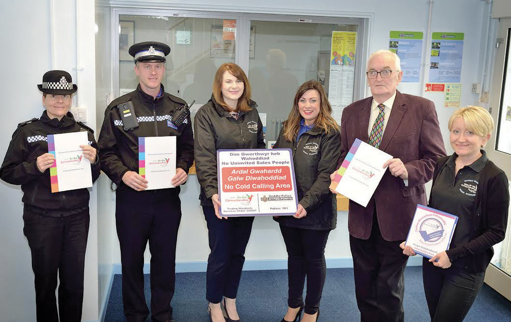From left, Sgt Rhian Curtis and PCSO Alan Davies: With Carmarthenshire County Council Trading Standards officers Kayleigh Phillips, Quita Davies and Viv Jones