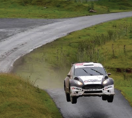 Tricky conditions: Elfyn Evans won stage five despite the conditions