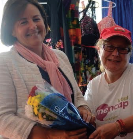 Cllr Elizabeth Evans (left): Receiving flowers from Katherine Taylor (right)