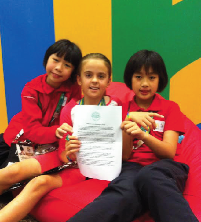 Memories: Millie gives her letter to her new friends from China