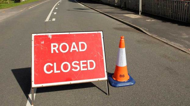 123857-road-closed-sign-quality-image