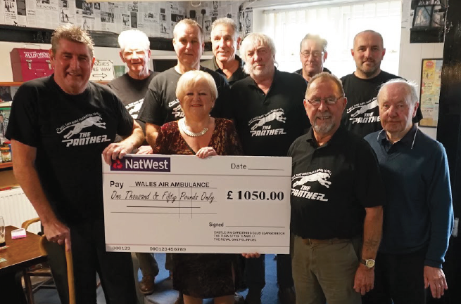 Presenting the cheque for over £1,000: To Wales Air Ambulance