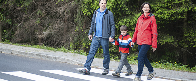 Father and Mother with their Son crossing the Road